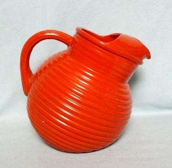 Anchor Hocking Tangerine Fired-on Rainbow Tilt Ball Juice Pitcher w Ice Lip - Product Image